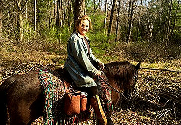 Owner Cynthia Sweeley on a horse.